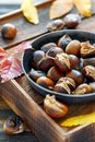 Roasted chestnuts in a cast iron skillet. Royalty Free Stock Photo