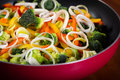 Frying pan with vegetables colorful close up Royalty Free Stock Photo