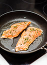 Frying salmon raw in a pan Stock Photos
