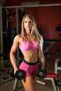 Ftiness woekout - Popular beautiful aoung woman workout in fitne Royalty Free Stock Photo