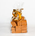 Fudge gift in clear bag on white background Royalty Free Stock Photo