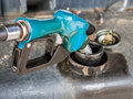 Fuel nozzle filling gas in a gas station Royalty Free Stock Photography