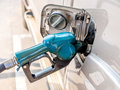 Fuel nozzle filling gas in a gas station Stock Images