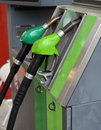 Fuel nozzle at a gas station Royalty Free Stock Photo