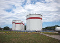 Fuel oil tanks over blue sky Stock Image