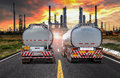 Fuel Tanker Truck on the road at refinery oil in sunset Royalty Free Stock Photo
