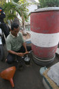 Fuel traders measure in karimun island central java indonesia Stock Photography