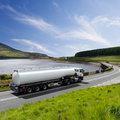 Fuel truck driving on highway Stock Photos