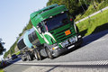 Fuel truck on the move large close ups and ground level perspective focal point side Stock Images