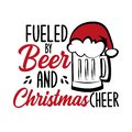 Fueled by beer and Christmas cheer - funny text , with Santa`s cap on beer mug. Royalty Free Stock Photo