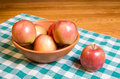Fuji apples in a wooden bowl Royalty Free Stock Images