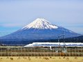 Fuji and train a bullet passes below mt in japan Stock Images