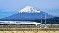 Fuji and train a bullet passes below mt in japan Royalty Free Stock Photos