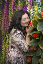 Full Asian woman in the room with flowers. Royalty Free Stock Photo