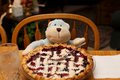Full Berry Pie Ready to Eat by a Toy Monkey for a Meal Royalty Free Stock Photo