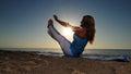 Full boat yoga pose on beach Royalty Free Stock Photo