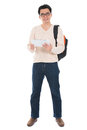Full body asian adult student using tablet pc in casual wear digital computer standing isolated on white background male Royalty Free Stock Image