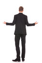 Full body back view of a business man welcoming Stock Photo