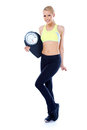 Full body of blond sporty woman holding scale over white background Royalty Free Stock Photos