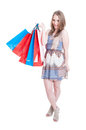 Full body of glamour woman doing shopping in her freetime and holding colored paper bags isolated on white studio background Stock Photos