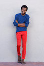 Full body handsome african american man smiling with arms crossed Royalty Free Stock Photo