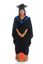 Full body happy indian university student in graduation gown and cap standing isolated on white background Stock Image