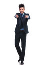 Full body picture of a business man pointing his fingers young smiling to you Stock Images