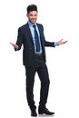 Full body picture of a young business man welcoming you on white background Stock Photography