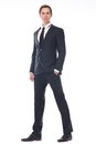 Full body portrait of a handsome young businessman in black suit isolated on white background Royalty Free Stock Images