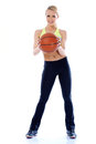 Full body shoot of sporty woman holding basket ball over white background Royalty Free Stock Photography