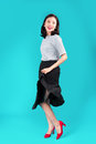 Full body of smiling asian woman dressed in pin-up style dress o Royalty Free Stock Photo