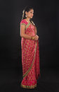 Full body traditional young indian girl in sari costume standing isolated on black background Royalty Free Stock Photography