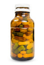 Full bottle of various multicolored pills Royalty Free Stock Photo
