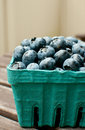 Full box of blueberries on the table outside side view Stock Image