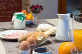 Full breakfast table ready to be served in a hotel Royalty Free Stock Photo