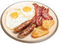 Full cooked english breakfast fried with eggs sausages bacon and hash browns Royalty Free Stock Image