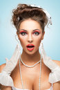 Full of emotions the retro photo a shocked and surprised bride with stylish makeup in a showing strong Stock Photos