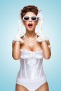 Full of emotions the retro photo a shocked and surprised bride with stylish makeup in a vintage corset showing strong Royalty Free Stock Images