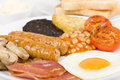 Full english breakfast traditional fry up with egg bacon mushrooms tomatoes sausages black pudding hash browns and baked beans Royalty Free Stock Photo
