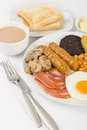 Full english breakfast traditional fry up with egg bacon mushrooms tomatoes sausages black pudding hash browns and baked beans Royalty Free Stock Photography