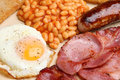 Full english cooked breakfast with bacon sausage fried egg and baked beans Stock Images