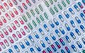 Full frame of colorful capsule pills in blister pack arranged with beautiful pattern. Pharmaceutical packaging. Medicine for infec Royalty Free Stock Photo