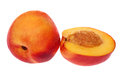 Full and half nectarine on white Royalty Free Stock Photo