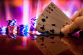 Full house poker cards combination on blurred background casino luck fortune