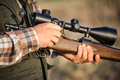 Full hunter hunting rifle with shotgun on the field Royalty Free Stock Photo