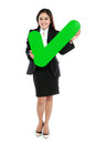 Full lenght of businesswoman holding check mark sign on white background Royalty Free Stock Photo