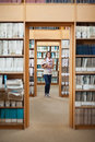 Full lenght of a female student standing in the library portrait smiling Stock Photos