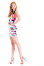 Full lenght model beautifull young blond woman in the studio with a colorfull dress Stock Image