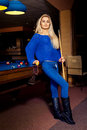 Full lenght portrait of fashionable blonge girl near pool table Royalty Free Stock Photo