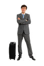 Full length of business man standing near luggage Royalty Free Stock Photo
